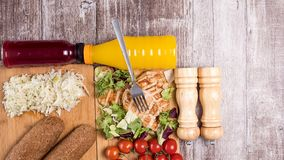 Stop motion footage of delicous healthy food on wooden background. Stop motion footage of delicous healthy food on wooden boards getting in the frame stock footage