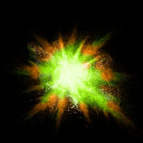 Stop motion of green and orange dust explosion isolated on black Royalty Free Stock Photos