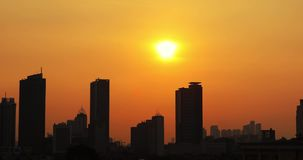 Stop motion of Jakarta city scenery at sunset. Stop motion footage of beautiful Jakarta city scenery with silhouette of skyscrapers at sunset time. Shot in 4k stock footage