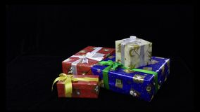 Stop motion of lettering Xmas and gift boxes isolated on black background. stock video