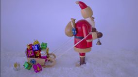 Stop motion - Santa Claus pulling a sleigh. stock footage