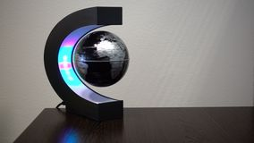Stop motion of toy globe spinning