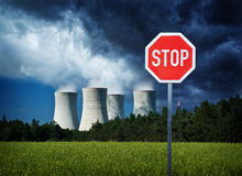 Stop nuclear power. Stop sign by the nuclear power station as a concept for stoping of nuclear pollution Royalty Free Stock Photos