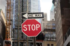 `Stop ` and `One way ` road signs in New York stock photos
