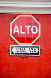 Stop and one way signs in spanish alto una via Stock Photos