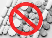 Stop Opioids. Painkillers crisis and drug abuse concept. Opioid. And prescription medication addiction epidemic. Different kinds of multicolored pills stock photography