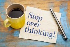 Stop overthinking reminder on napkin stock photo