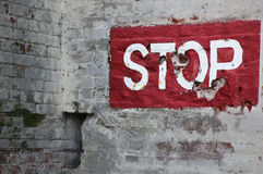 Stop Painted on Brick Wall Stock Image