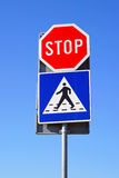 Stop pedestrian crossing. Stop sign and pedestrian crossing at traffic pole Royalty Free Stock Images