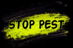 Stop pest word with glow powder royalty free stock photography