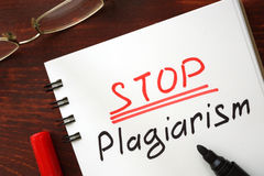 Stop plagiarism sign written. Stop plagiarism sign written in a notepad Royalty Free Stock Photography