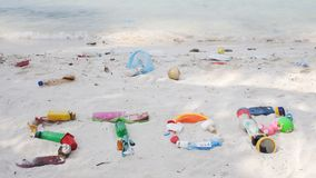 Stop Plastic Waste. The Word Stop Written With Washed Up Plastic Debris On A White Beach In The Maldives. Ecological Message To The World stock images