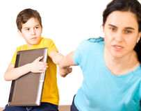 Stop playing. Mother warning her son to stop playing - isolated stock photography