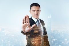 Confident manager showing his palm. Stop please. Confident serious manager showing his palm to you while being slightly hostile Royalty Free Stock Images