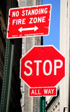 Stop. Prohibitory stop traffic sign with the warning about fire zone Stock Image