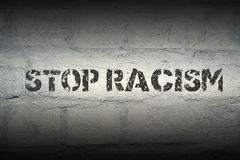 Stop racism GR. Stop racism stencil print on the grunge white brick wall Royalty Free Stock Images