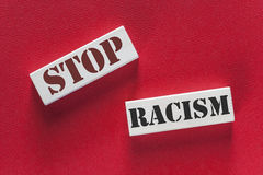 Stop racism message. Written on wooden tiles Royalty Free Stock Photos