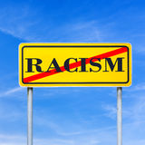 Stop racism. Word racism written on yellow read sign and crossed off Stock Photography