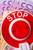 STOP red sign with euro money cash in white plate. STOP red sign on euro money cash, corruption concept royalty free stock photo