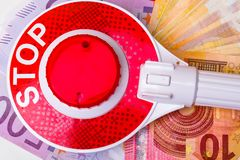 STOP red sign with euro money cash in white plate. STOP red sign on euro money cash, corruption concept royalty free stock photos