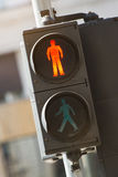 Stop. Red sign for walkers on semaphore. Toned photo, low contrast Royalty Free Stock Photo