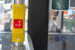 Stop on request button on bus Royalty Free Stock Images
