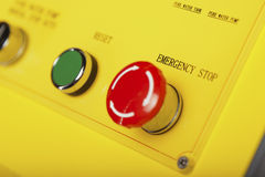 Stop and reset button. Red emergency stop switch and green reset button Royalty Free Stock Image