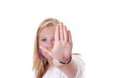 Stop right there!. Girl holding hand up saying stop. Face visible Royalty Free Stock Photo