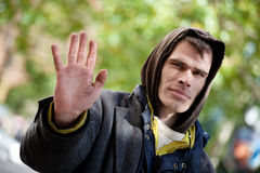 STOP right there Homeless Men with hand up. Young Homeless Men with hand outstretched, warding off any unwelcome situations Royalty Free Stock Photography
