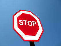 Stop road sign. Isolated in pure blue sky as background Royalty Free Stock Images