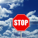 Stop. Road sign over cloudy sky Royalty Free Stock Photos