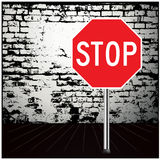 Stop Road signs. Surface road sign and black brick wall Royalty Free Stock Photo