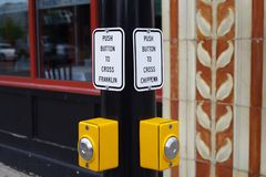 Stop on the road at traffic lights to cross, buttons in Buffalo NY stock images