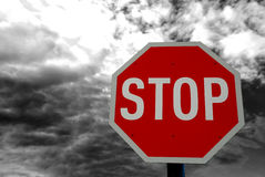 Stop Road Traffic Sign. Image of a red traffic road stop sign against dark cloudy sky abstract stock images