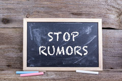 STOP RUMORS. Text on blackboard Royalty Free Stock Images