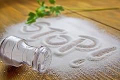 Stop salt – medical concept. STOP written on a heap of salt - antihypertensive campaign health hazard stock photography