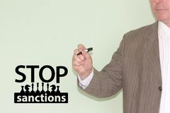 Stop sanctions concept. a man in a jacket stock photos