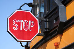 Stop for Schoolbus. Closeup of schoolbus with stop sign extended for approaching traffic. Blue sky in background. Horizontal format Royalty Free Stock Photography