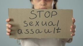 Stop sexual assault poster in bruised woman hands, problem awareness prevention. Stock footage stock video