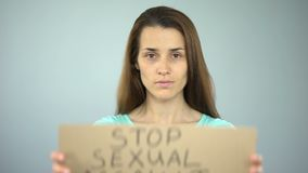 Stop sexual assault sign in womans hands, female rights protection, awareness. Stock footage stock footage