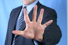 Stop sign. Businessman's hand making a stop sign Stock Photography