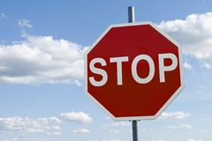 Stop sign. Against the cloudy sky Royalty Free Stock Image