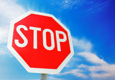 Stop sign. Isolated stop sign against blue background Royalty Free Stock Photos