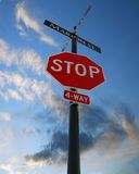 Stop Sign. 4 way Stop sign with sunset background Royalty Free Stock Photo