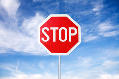 Stop Sign. Stop road sign on the blue sky background royalty free stock photos