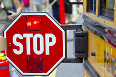 Stop sign. With the flashing red light on the school bus stock photography