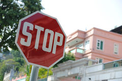 Stop sign. And building exterior in the background Stock Image