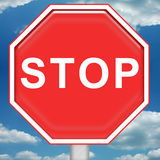 Stop Sign. Bright red stop sign with blue sky background stock illustration