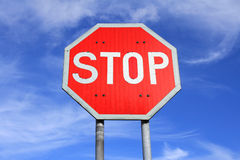 Stop Sign. Traffic stop sign against blue sky with some clouds stock image