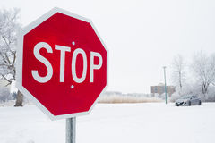 Stop sign. Stop road sign in snowy day in winter. Canada Stock Photo
